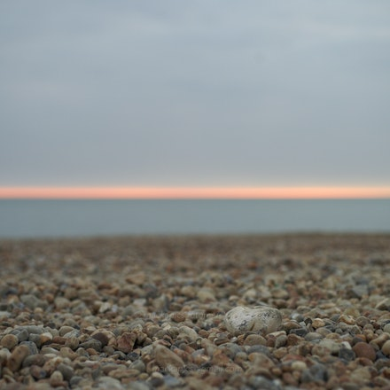 Sunset Glow - The flint-rich beach at Seaford, East Sussex.