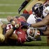 Ravens D - LaMichael James (23) of the San Francisco 49ers is tackled in first-half play against the Baltimore Ravens in Super Bowl XLVII at the Mercedes-Benz...