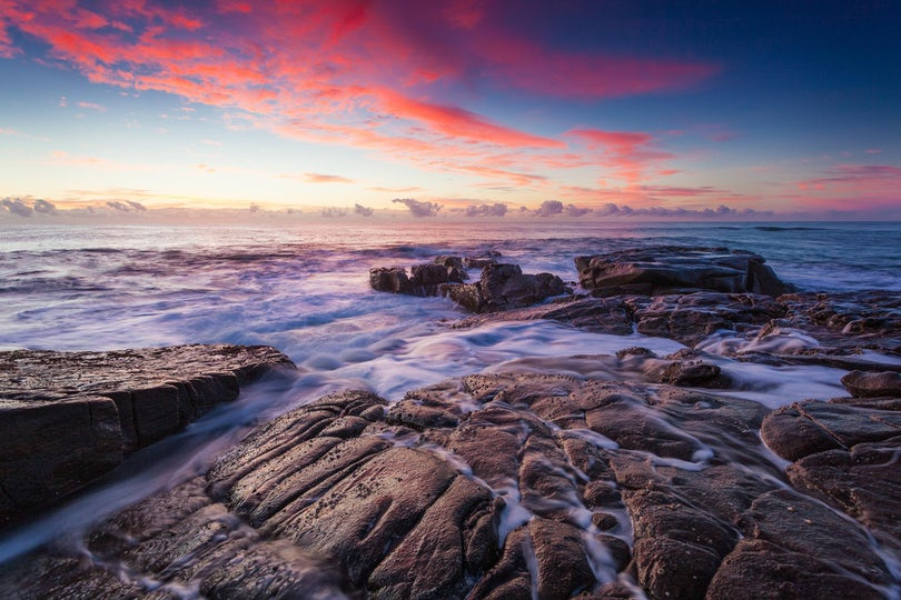 Awash - Point Arkwright, Queensland - As I walked along the rocks, in the early pre dawn light the sky was mostly clear. Yet, as the light began to glimmer...