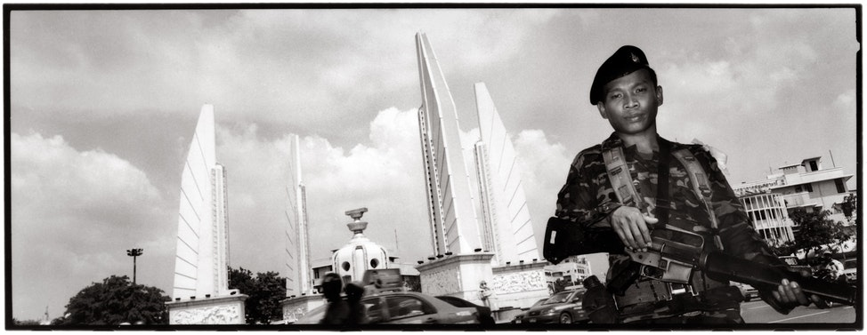 Protecting Democracy? - A soldier mans a military checkpoint at Bangkok's Democracy Monument intersection the morning after the Royal Thai Army overthrew...