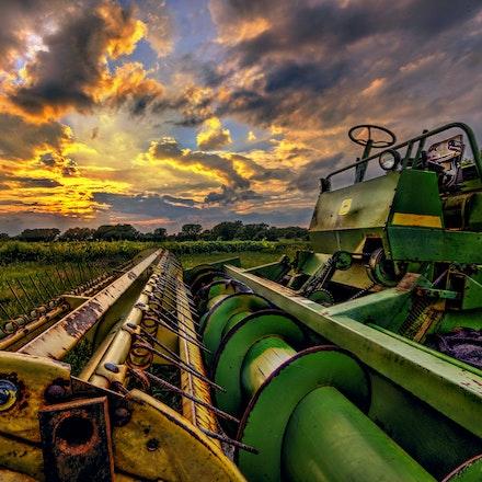 John Deere 9.7.2016.6 - John Deere. A John Deere tractor's signature colors compliment the surrounding Nebraska sunset and farm field. #nebraska #tractor...