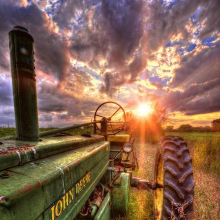 Deere Model B   9.7.2016.11 - Deere Model B. The sun sets behind a vintage John Deere tractor resting in a Lancaster County, Nebraska farm field. #sunset...