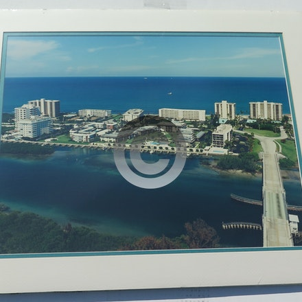 JUPITER ISLAND CONDOS 0059 - This 16 x 20 aerial is vacuum mounted with double mats and shrink wrapped.  Ready for a 20 x 24 frame!